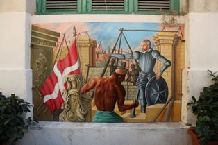 Mural in Valletta showing city's construction *