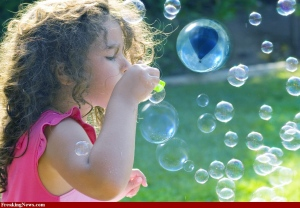 balloon in bubbles with girl