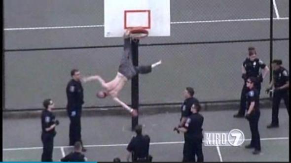 Shirtless-hammer-wielding-man-rescued-from-Seattle-basketball-hoop