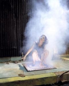 Woman in smoke Artist unknown